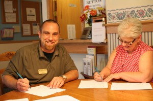 Eric and customer filling out move in paperwork