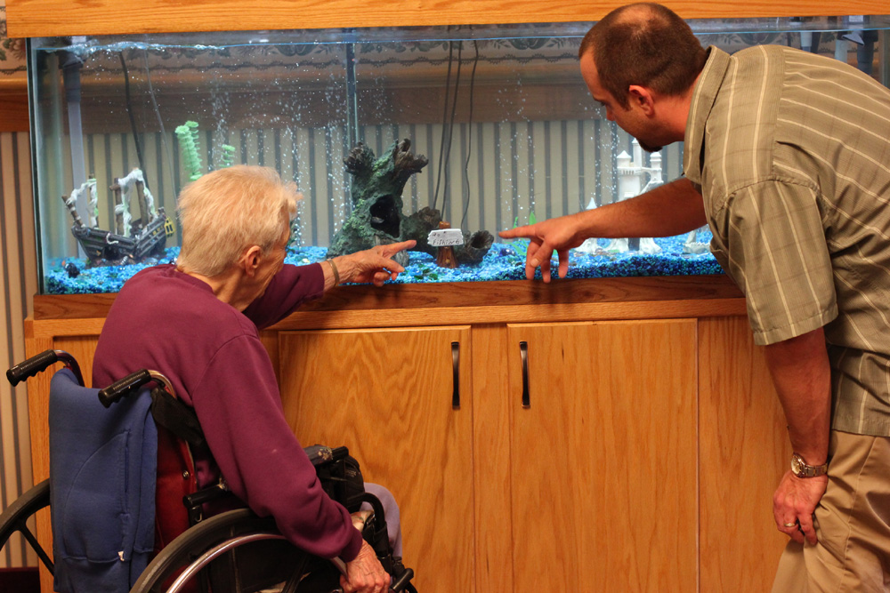 Eric and resident admiring the fish tank